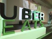 Uber will seinen Dienst für Essenslieferungen in der Romandie lancieren. In den USA deckt Uber Eats bereits rund die Hälfte der Bevölkerung ab. (Bild: Keystone/AP/LEE JIN-MAN)