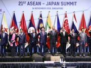 Gruppenbild vom Asean-Gipfel am Mittwoch in Singapur. (Bild: Keystone/AP/YONG TECK LIM)