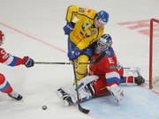 Der neue EVZ-Ausländer Dennis Everberg (im gelben Trikot) wurde mit Schweden 2017 und 2018 Weltmeister (Bild: KEYSTONE/EPA/SERGEI ILNITSKY)