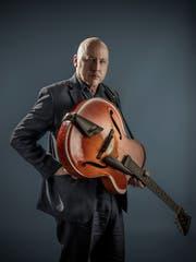 Gitarrist und Sänger Mark Knopfler.