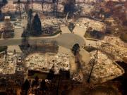 Im Zuge der verheerenden Waldbrände in Kalifornien werden über 600 Menschen vermisst. (Bild: KEYSTONE/FR34727 AP/NOAH BERGER)