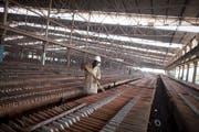Ein Mitarbeiter der Kupfer- und Kobaltmine von Katanga in der Republik Kongo. Bild: Simon Dawson/Bloomberg