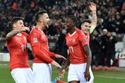 Haris Seferovic celebrates after scoring 5-2 with Steven Zuber, Denis Zackaria and Granit Xhaka. (Image: Urs Lindt / freshfocus)