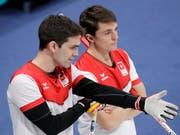 Skip Peter De Cruz (links) und Benoît Schwarz müssen sich etwas einfallen lassen (Bild: KEYSTONE/AP/AARON FAVILA)