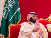 Anzeige von Aktivisten: Für den saudischen Kronprinzen Mohammed bin Salman könnte es beim G-20-Treffen in Argentinien ungemütlich werden. (Bild: KEYSTONE/EPA SAUDI ROYAL COURT/BANDAR/SAUDI ROYAL COURT HANDOUT)