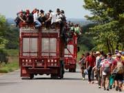 Der Uno-Migrationspakt will die Migration in geordnete Bahnen lenken. Doch der Widerstand dagegen wächst. (Bild: KEYSTONE/AP/MARCO UGARTE)