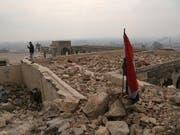 Fast die Hälfte der entdeckten Massengräber befinden sich in der Region Mossul. (Bild: KEYSTONE/AP/KHALID MOHAMMED)