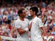 Rafael Nadal und Novak Djokovic behalten - irgendwie - ihre Weisse Weste (Bild: KEYSTONE/EPA REUTERS POOL/ANDREW COULDRIDGE / POOL)