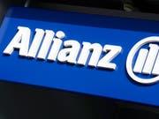 Beim Versicherer Allianz klingeln die Kassen. (Bild: KEYSTONE/WALTER BIERI)