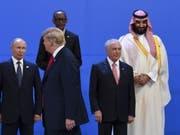 Gelegenheiten zu Treffen auch unter vier Augen am Rande des G20-Gipfel bieten sich zuhauf. Von links nach rechts: der russische Präsident Wladimir Putin, sein amerikanischer Amtskollege Trump, der brasilianische Staatschef Temer und der saudische Kronprinz Mohammed bin Salman. (Bild: KEYSTONE/EPA AAP/LUKAS COCH)