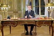 Präsident Macron bei seiner TV-Rede aus dem Elysée-Palast. (Bild: Ludovic Marin/EPA (10. Dezember 2018))