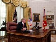 «Den USA geht es sehr gut. Frohe Weihnacht!»: US-Präsident Donald Trump. (Bild: KEYSTONE/AP/JACQUELYN MARTIN)