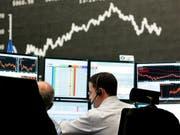 Die Aktienmärkte finden kurz vor Jahresende keinen Boden: Auch in der Schweiz fallen die Kurse am Donnerstag weiter. (Bild: KEYSTONE/AP/MICHAEL PROBST)