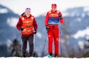 Markus Cramer mit dem russischen Athleten Sergej Ustjugow. (Bild: Jon Olav Nesvold/Imago (Oberstdorf, 2. Januar 2018))