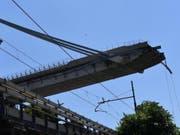Die Morandi-Brücke in Genua einen Tag nach ihrem Zusammensturz Mitte August. 43 Menschen waren ums Leben gekommen. (Bild: Keystone/EPA ANSA/LUCA ZENNARO)