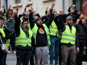 Die französischen «Gelbwesten» sind am Samstag erneut auf die Strasse gegangen. (Bild: KEYSTONE/AP/BOB EDME)