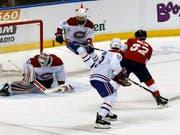 Denis Malgin trifft gegen Montreal aus dem Slot heraus (Bild: KEYSTONE/FR171174 AP/JOE SKIPPER)