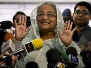 Die amtierende Regierungschefin Sheikh Hasina erklärt sich schon mal als Siegerin. (Bild: KEYSTONE/AP/ANUPAM NATH)