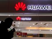 Der Konflikt um die Festnahme der Finanzchefin des chinesischen Konzerns Huawei in Kanada geht weiter - China bestellt den kanadischen Botschafter in Peking ein. (Bild: KEYSTONE/AP/NG HAN GUAN)
