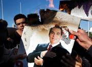 60 Millionen Franken des tunesischen Ex-Diktators Ben Ali und seiner Verbündeten sind derzeit auf Schweizer Konten gesperrt. (Bild: AP/Christophe Ena)