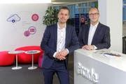 Sie werden künftig noch enger zusammenarbeiten: Olvier Stahel, CEO Arcade Solutions AG und Stephan Marty, CEO Energie Wasser Luzern (ewl). (Bild: pd)