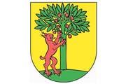 Das Original: Das Wappen der Gemeinde Risch zeigt einen roten Luchs, der linksseitig einen grünen, buschigen Baum hinaufzuklettern scheint. Der Hintergrund des Wappens ist in Gelb gehalten.