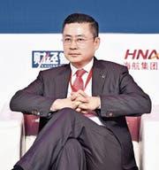 Der HNA-CEO Adam Tan bestreitet die Finanzprobleme. (Bild: Niu Bo/Keystone (Peking, 28. November 2017))