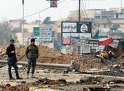 Irakische Polizisten nahe der umkämpften Stadt Mossul. (Bild: Achmed Jalil/AP (20. März 2017))