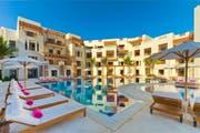 Jebel Sifah, das neue Resort von Samih Sawiris' Orascom in Oman, soll von der Übernahme der FTI und der Raiffeisen-Touristik profitieren. (Bild: PD)