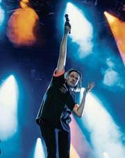 Arcade-Fire-Frontmann Win Butler bei seinem Konzert am Paléo Festival. (Bild: Jean-Christophe Bott/Keystone)