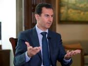 """Syriens Präsident Baschar al-Assad: """"Wir haben keine Chemiewaffen. 2013 haben wir auf unser gesamtes Arsenal verzichtet."""" (Archivbild) (Bild AP/Syrian Presidency/)"""