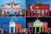 Beleuchtung beim Brandenburger Tor als Zeichen der Solidarität für Terroropfer: Die russische Flagge fehlt. (Bilder: Keystone)