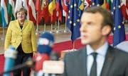 Merkel und Macron bei ihrer Ankunft zum EU-Gipfel in Brüssel. (Bild: Stéphanie Lecocq (14. Dezember 2017))