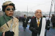 Bundesrat Hansruedi Merz und Libyens Staatspräsident Muammar Ghadaffi. (Bild René Meier/Zisch)