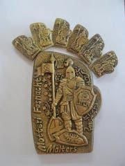 Die neue Fasnachts-Plakette des Motteri-Rats zeigt den «Ritter von Malters», begleitet von drei unterschiedlichen (Gemeinde)-Wappen. (Bild: PD)