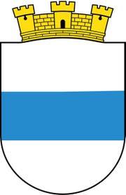 Das Original: Weiss, blau, weiss: einfach und prägnant. So ist das Stadtzuger Wappen, dem Anfang des 20. Jahrhunderts am oberen Rand eine gelbe Burgmauer hinzugefügt wurde. Dies deshalb, damit man es von dem an den Kanton entlehnten Wappen unterscheiden kann, das ein dunkleres Blau für den Balken besitzt.