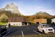 So könnte die neue Talstation der Rotenfluh-Bahn aussehen, rechts hinten das Parkhaus. (Bild: Visualisierung Architron)