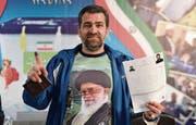 1499 Männer und 137 Frauen wollen bei der Präsidentschaftswahl im Iran am 19. Mai antreten. Frauen ist die Kandidatur durch die Verfassung untersagt. (Bilder: Getty)