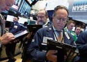 Starke Firmenbilanzen stützen die New York Stock Exchange. (Bild: Richard Drew/Keystone (New York, 16. November 2017))