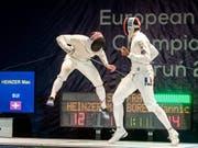 Max Heinzer (links) riskierte im EM-Final gegen Yannick Borel (rechts) alles (Bild: KEYSTONE/EPA PAP/TYTUS ZMIJEWSKI)