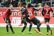 epa05207945 Ingolstadt's Dario Lezcano (3rd L) celebrating after the 3:1 goal during the German Bundesliga soccer match between FC Ingolstadt and VfB Stuttgart at Audi Sportpark in Ingolstadt, Germany, 12 March 2016. ..(EMBARGO CONDITIONS - ATTENTION: Due to the accreditation guidlines, the DFL only permits the publication and utilisation of up to 15 pictures per match on the internet and in online media during the match.) EPA/ARMIN WEIGEL (Bild: ARMIN WEIGEL (EPA DPA))