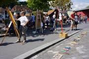 Demonstrierten mit Halbfertigem gegen Sparmassnahmen im Kunstbereich: Kunstschaffende am Mühleplatz in Luzern. (Bild: PD/Catherine Huth)