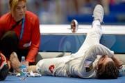 Max Heinzer wird immer wieder von den Schmerzen im linken Fuss eingeholt: Im Juli musste er sich in Kasan während des Wettkampfs behandeln lassen. (Bild: Keystone/Waleri Melnikow)