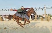 Reiter auf dem traditionellen Festival Souk Okaz bei Taif, was jedes Jahr Zehntausende Besucher anzieht. (Bild: Katharina Eglau)