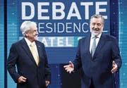 Präsidentschaftskandidaten: Sebastian Pinera (links) und Alejandro Guillier bei einer TV-Debatte. (Bild: Elvis Gonzales/EPA (Santiago, 11. Dezember 2017))