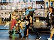 Russland hat mit 150 Millionen Konsumenten Potenzial – doch es gilt, wichtige Punkte zu beachten. (Bild: Srdjan Suki/EPA (St. Petersburg, 28. Juni 2017))