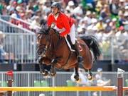 Ritt mit Problemen: Steve Guerdat hatte wie die anderen Schweizer an der Niederlage zu knabbern. (Bild: Keystone/Peter Klaunzer)