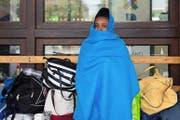 Eine Eritreerin am Bahnhof von Como. (Bild: Keystone/Francesca Agosta)