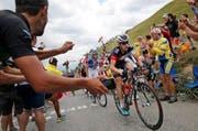 Der Luzerner Mathias Frank, im Bild in der 19. Etappe nach La Toussuire, erreicht Gesamtrang 8. (Bild: AP / Laurent Cipriani)