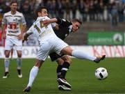Unentschieden im Tessin: Luganos Mattia Bottani (rechts) gegen Luzern Jerome Thiesson (Bild: KEYSTONE/TI-PRESS/GABRIELE PUTZU)